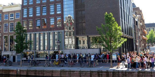 People wait in line to visit the Anne Frank House in Amsterdam, Friday, June 6, 2014. Amsterdam's mayor Eberhard van der Laan says he has ordered extra security measures around the city's historical Jewish monuments on advice of the country's anti-terrorism office. Van der Laan said he is not aware of any concrete threat to Jewish places of interest, but an attack is 'conceivable' in the wake of an attack on the Jewish Museum in Brussels, Belgium last month which left three people dead. Spokespeople for the city and the museums declined to comment on what additional measures are being taken, citing security concerns. (AP Photo/Margriet Faber)