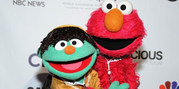 NEW YORK, NY - SEPTEMBER 27:  Sesame Street muppets Raya (L) and Elmo attend VIP Lounge at the 2014 Global Citizen Festival to end extreme poverty by 2030 in Central Park on September 27, 2014 in New York City.  (Photo by Ilya S. Savenok/Getty Images for Global Citizen Festival)