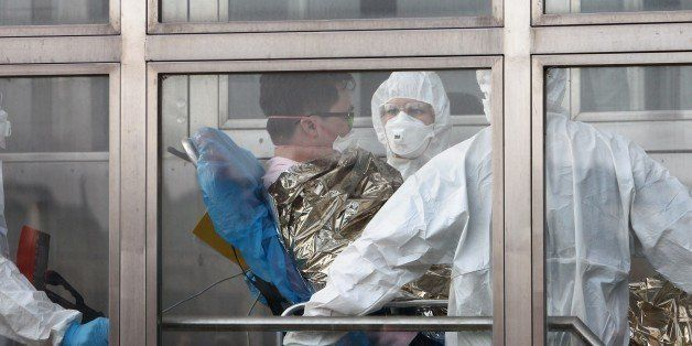 A South Korean patience suspected of suffering from Middle East Respiratory Syndrome (MERS) is admitted to Kramare hospital in Bratislava, Slovakia after the he was transported by medical staff from the Northern Slovak town of Zilina on June 13, 2015.  AFP PHOTO / STRINGER        (Photo credit should read STRINGER/AFP/Getty Images)