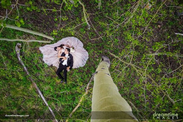 """""""Ivan and I got married at the Beaver Creek Wedding Deck. Our photographer is also an avid climber, and climbed an aspen tree"""