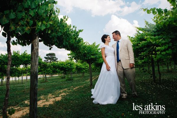 """""""Sara and Will take a stroll through Gregory Vineyards following their wedding ceremony at Campbell University's Chapel in Bu"""