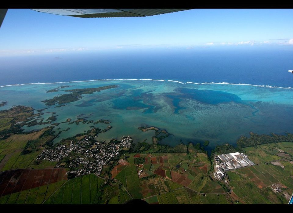 """Enjoy Mauritius's most spectacular scenic flight, 10,000 ft above the Indian Ocean, with <a href=""""http://www.skydivemauritius"""