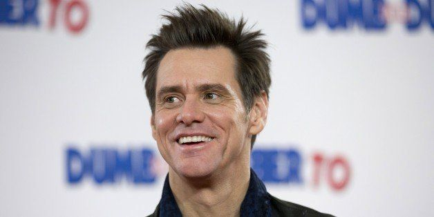 US actor Jim Carrey poses for photographers at a photocall for the film 'Dumb and Dumber To' in London on November 20, 2014. AFP PHOTO / JUSTIN TALLIS        (Photo credit should read JUSTIN TALLIS/AFP/Getty Images)