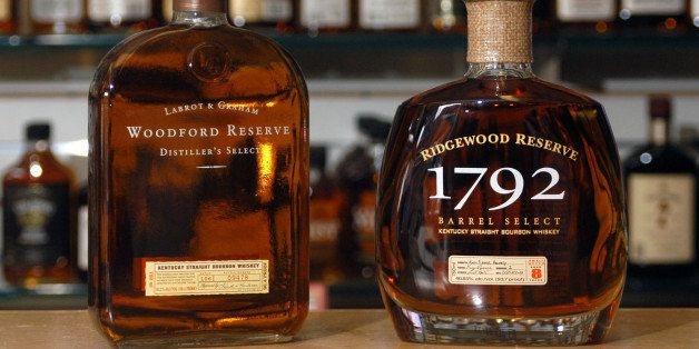 Bottles of Woodford Reserve premium bourbon, left, and Barton's Ridgewood Reserve, right, are shown Thursday, Feb. 12, 2004, in Louisville, Ky. Louisville-based Brown-Forman, the makers of Woodford Reserve, are accusing Barton's Ridgewood Reserve, right, of confusing buyers by distributing a copycat brand. Brown-Foreman has sued Barton in federal court, saying Barton has violated the federal Lanham Act, which prohibits unfair competition. (AP Photo/Brian Bohannon)