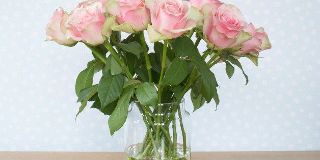 bouquet of pink roses in vase on table
