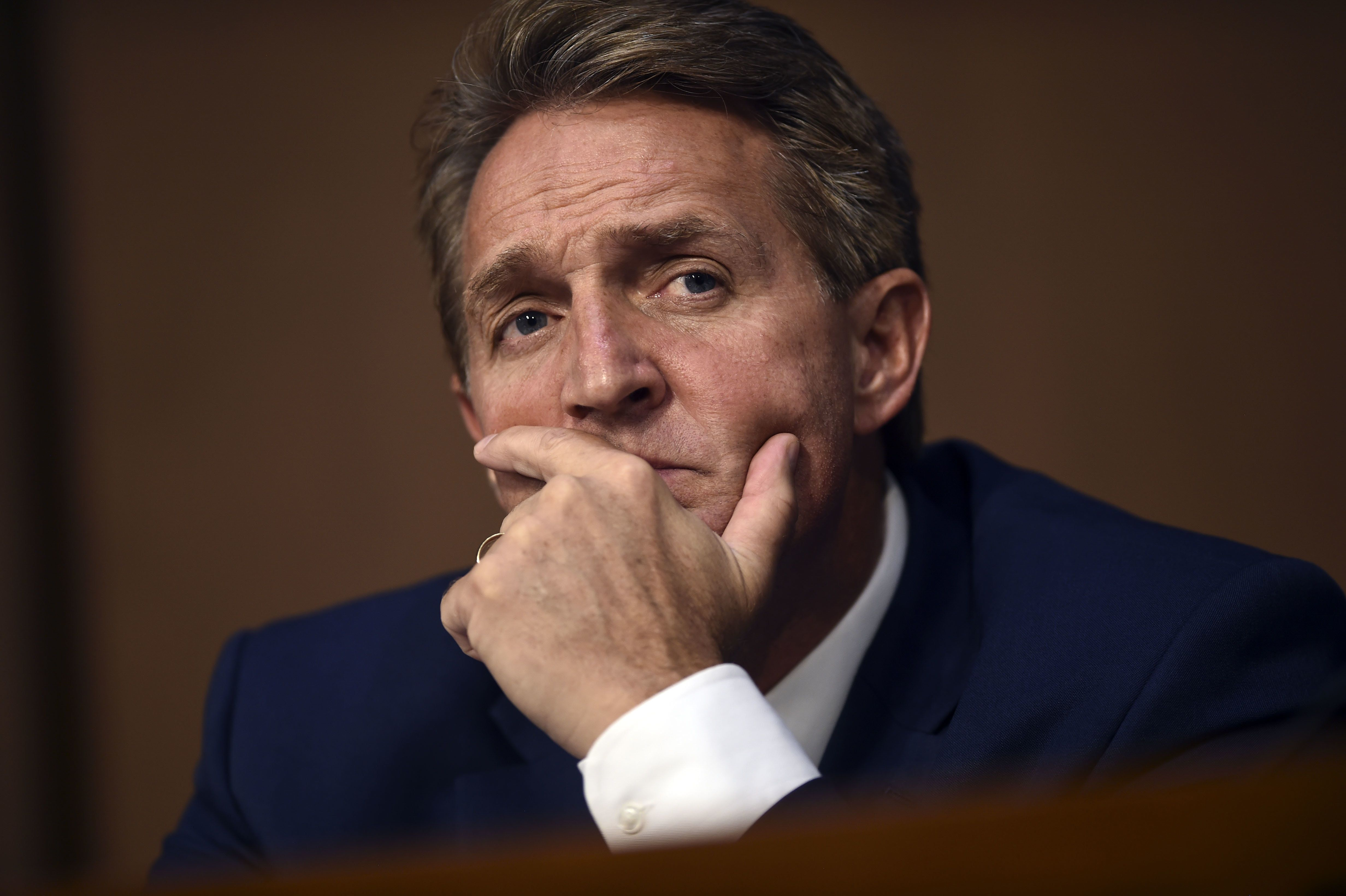 Sen. Jeff Flake(R-AZ) listens during Brett Kavanaugh's US Senate Judiciary Committee confirmation hearing to be an Associate Justice on the US Supreme Court, on Capitol Hill in Washington, DC, September 4, 2018. - President Donald Trump's newest Supreme Court nominee Brett Kavanaugh is expected to face punishing questioning from Democrats this week over his endorsement of presidential immunity and his opposition to abortion. (Photo by Brendan SMIALOWSKI / AFP)        (Photo credit should read BRENDAN SMIALOWSKI/AFP/Getty Images)