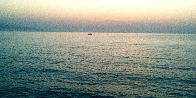 Rowboat In Sea At Dusk