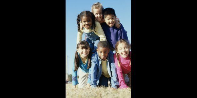 Portrait of a group of children making a human pyramid