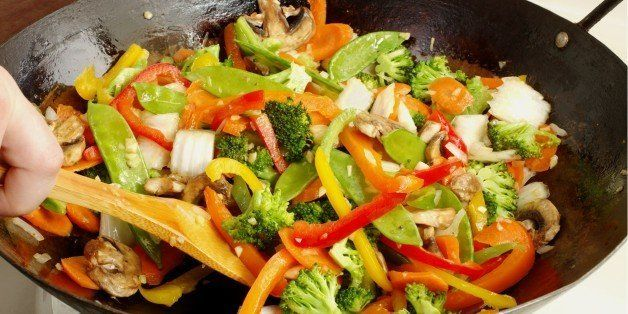asian style stir fry cooking in ...