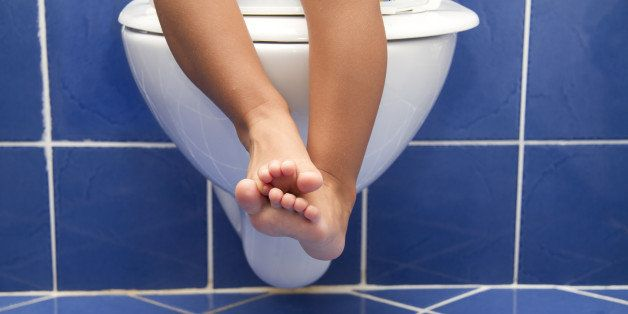 'the toddler, 3-years-old, is sitting on the toilet for toilet training potty or toiet training is the process of training a young child to use the toilet for urination and defecation.'