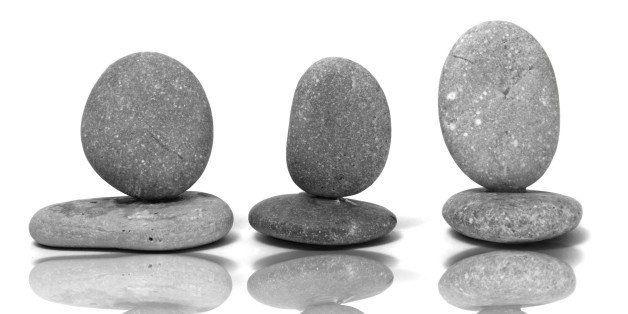 a zen stones on a white...