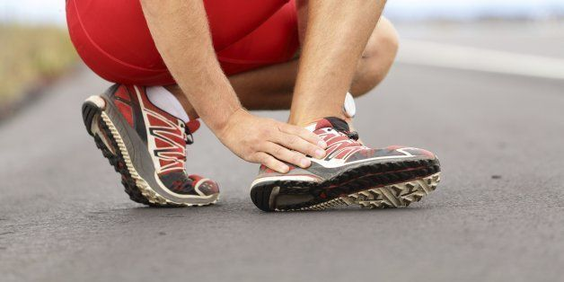 Broken twisted angle - running sport injury. Male runner touching foot in pain due to sprained ankle. Click for more: