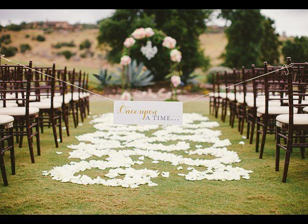 """A sweet sign marks the beginning to your fairy tale love story.  <strong>Related: <a href=""""http://www.bridalguide.com/plann"""