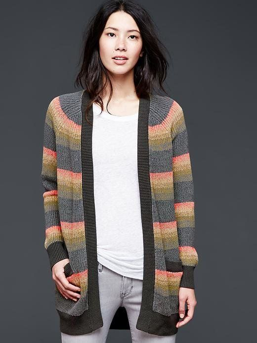 """And no, not a """"cardigan"""" or a """"light wrap"""" -- a sweater. A real, live, enormous, oversize sweater. Why? Because your office i"""