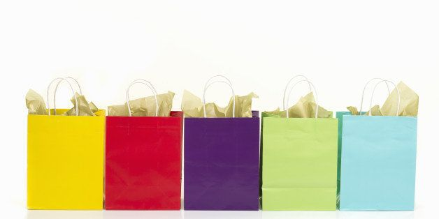 Colored shopping bags on white