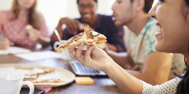 Business People Having Meeting Around Table And Eating Pizza