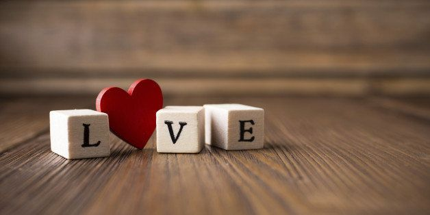 Love message written in wooden blocks. Red heart.