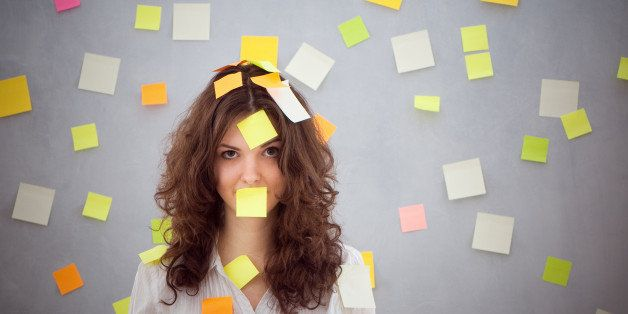 secretary overwhelmed with sticky reminder notes