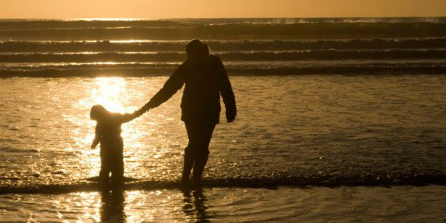 Mother and Child walking in the sea
