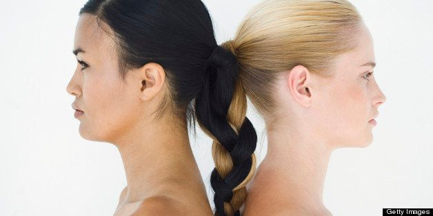 Two Young Women with Braided Ponytails