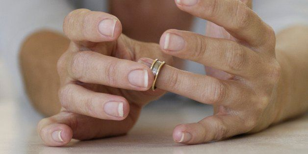 Close up of woman putting on ring