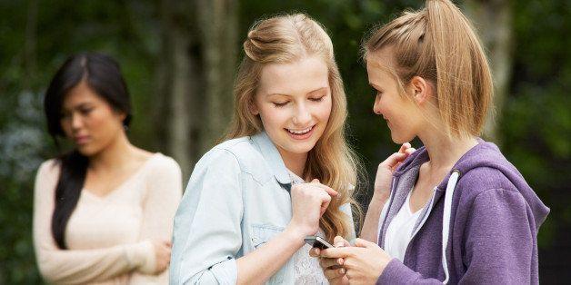 teenage girl being bullied by...