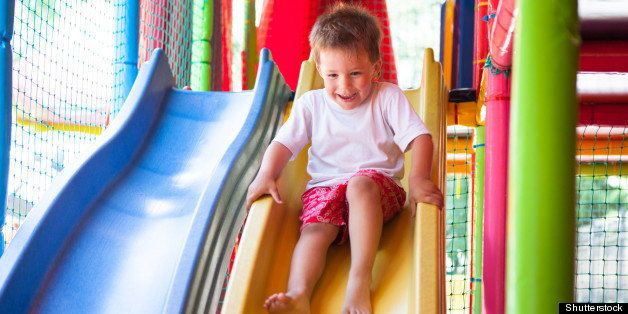 happy boy on slide