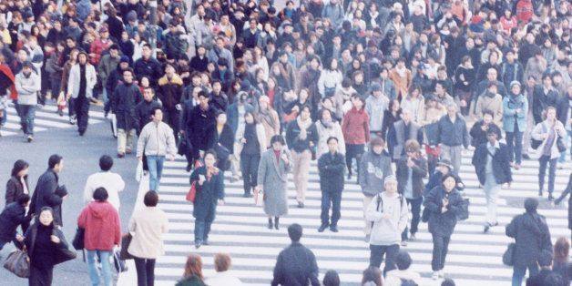 Large crowd of people crossing city street, Shibuya, Tokyo, Japan