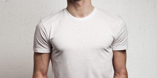 blank white t-shirt on muscle young man and white wall background