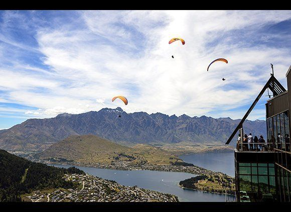 Hike, paraglide, and wine tour New Zealand's breathtaking landscape, known for Pinot Noir and Chardonnay production as well a