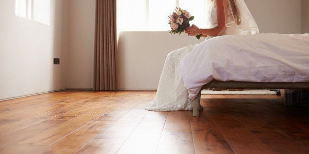 Bride In Bedroom Having Second Thoughts Before Wedding