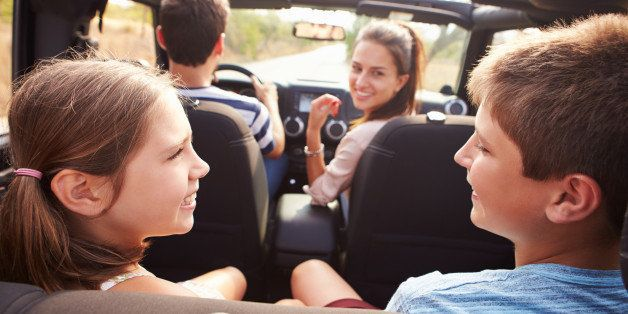 Parents Taking Children On Trip In Open Top Car
