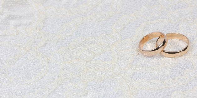 weddings golden rings on white...