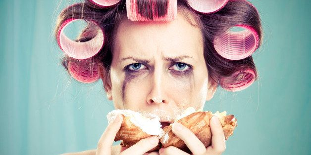 'Depressed, angry woman trying to drown her sorrow in a cream puff. Desperate Housewife.'