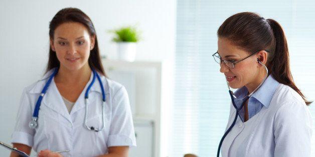 portrait of two female doctors...