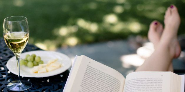 Peaceful time outside with good book, glass of wine, and plate of fruit and cheese.