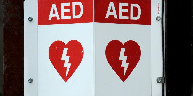 TELLURIDE, CO - JULY 8, 2014: A sign affixed to a building in Telluride, Colorado, advises the presence of an AED, or Automated External Defibrillator, a portable electronic device used in emergencies to treat cardiac arrhythmias. (Photo by Robert Alexander/Getty Images)
