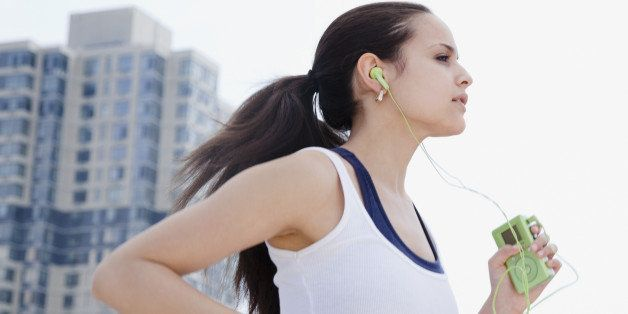 Mixed race woman jogging with mp3 player