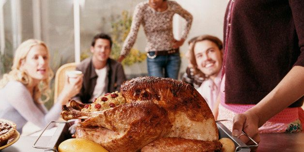Friends at a Thanksgiving Party, with the Roast Turkey in the Foreground
