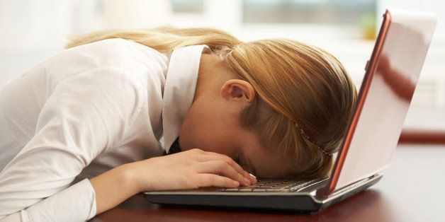Image of very tired businesswoman or student with her face on keyboard of laptop   Note to inspector: the image is pre-Sept 1 2009