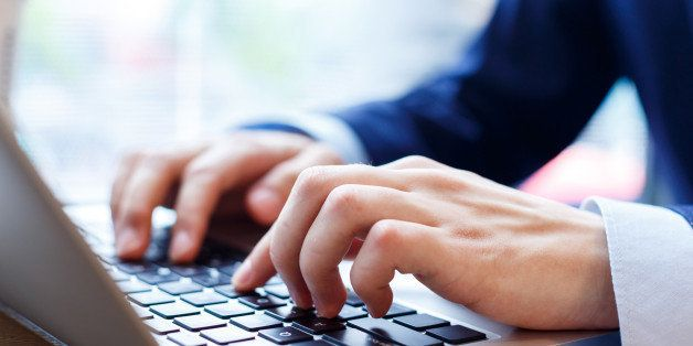 close up view of businessman typing on laptop indoors