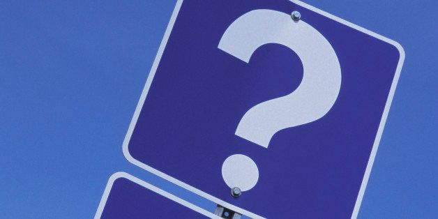 Road sign with arrow and question mark
