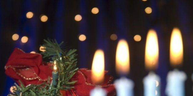 'A Hanukkah menorah and a Christmas tree together, symbolizing an interfaith holiday season. Focus is on the Christmas tree.'