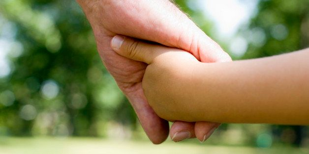 Grandfather and grandchild holding hands