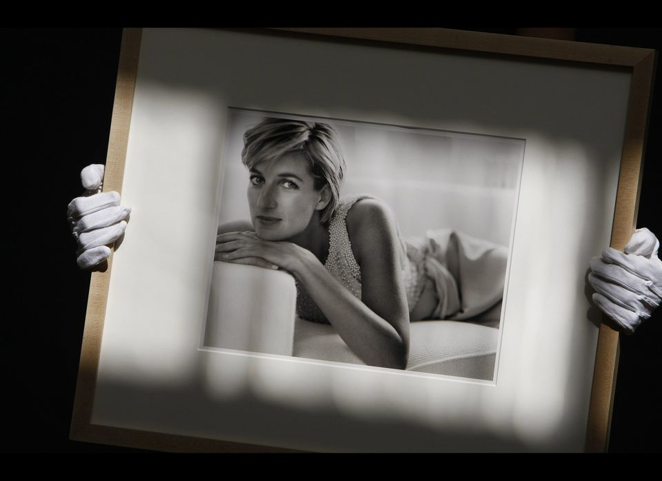 A Christie's employee holds a photograph of Diana, Princess of Wales by Mario Testino, dated 1997, at Christie's auction hous