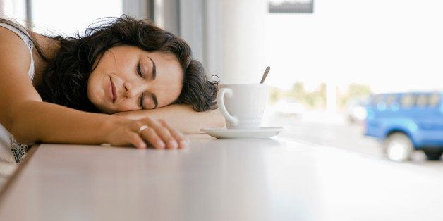 Woman sleeping in cafe