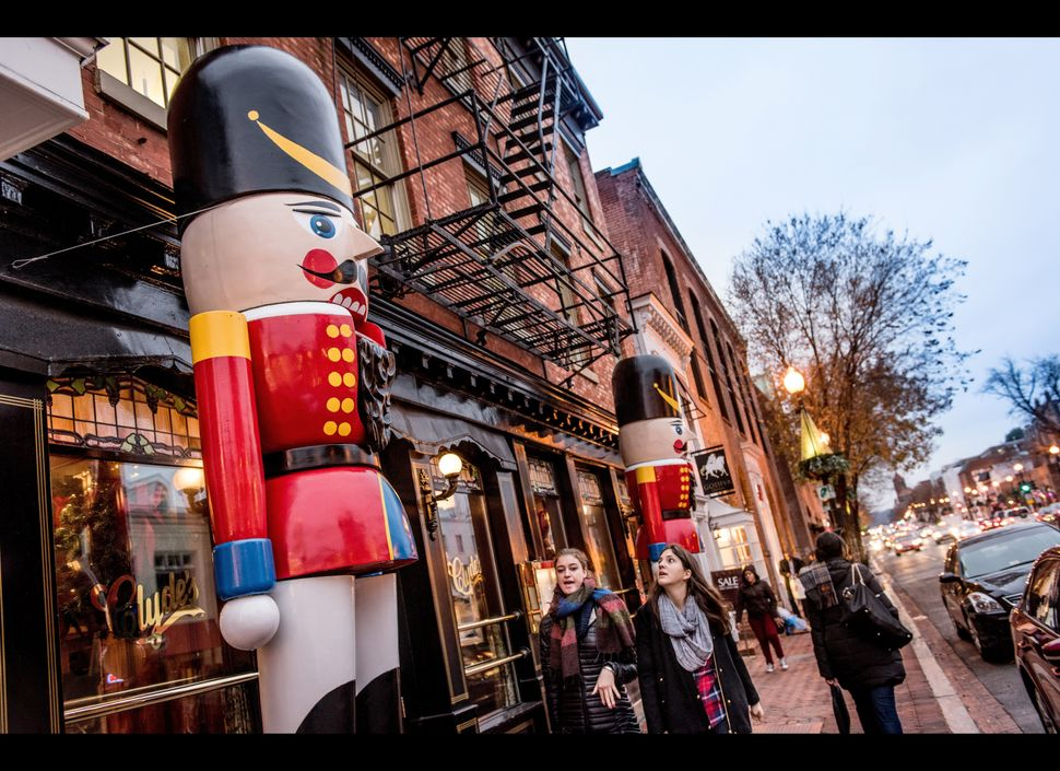 <strong>Where:</strong> Washington, D.C.  Washington D.C.'s oldest neighborhood comes alive each December with the warmth of