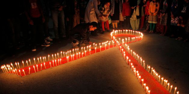 Nepalese women and children from ᅢ까タᅡワMaiti Nepalᅢ까タᅡン, a rehabilitation center for victims of sex trafficking, light candles on the eve of World AIDS Day in Kathmandu, Nepal, Monday, Nov. 30, 2015. World AIDS Day is observed on December 1 every year to raise the awareness in the fight against HIV. (AP Photo/Niranjan Shrestha)