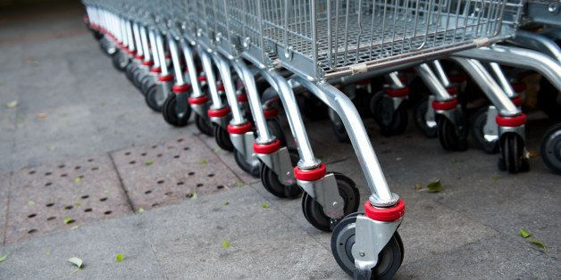 many empty shopping carts in a...
