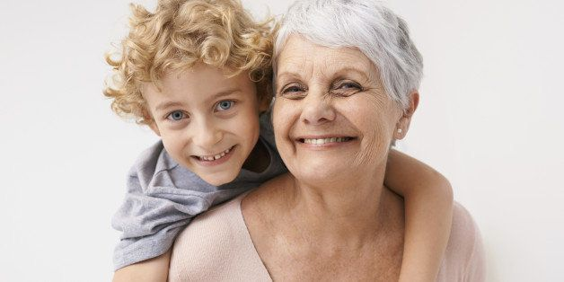 Portrait of a grandmother giving her grandson a piggyback ride